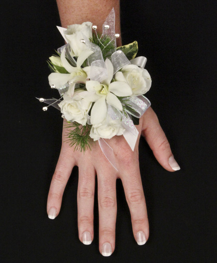 [Image: This beautiful white corsage is great for a wedding or prom. It features elegant white flowers with great details of pearls and greenery.]