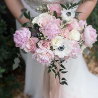 Garden mix bouquet of peonies, roses and anemones.