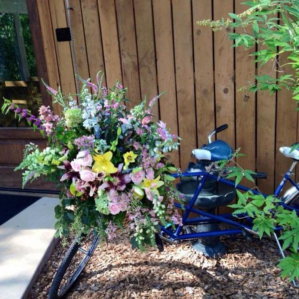 [Image: Custom arrangements like this bicycle built for two is always a favorite to see. ]
