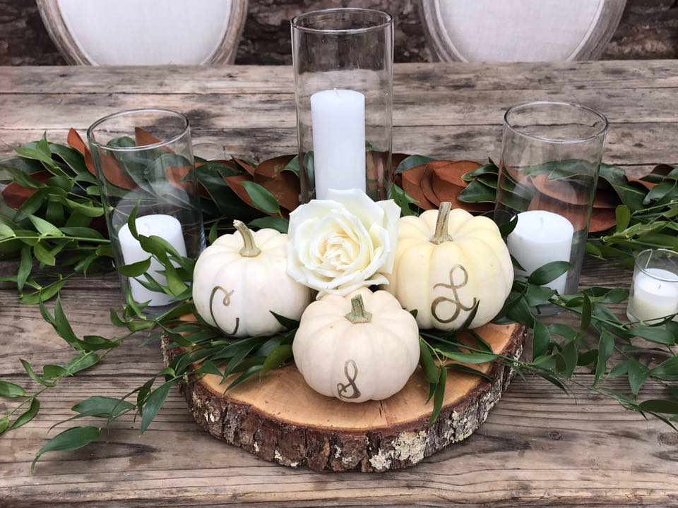 Floral centerpiece with white pumpkins