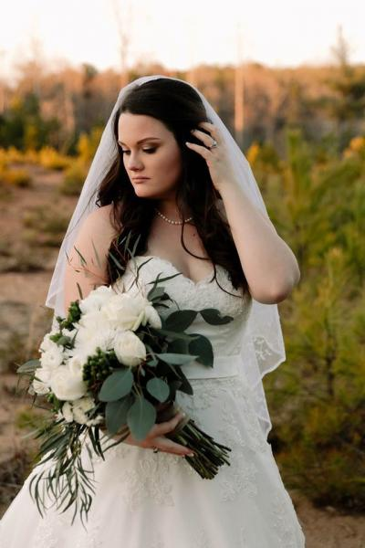 [Image: Romantic cascading white bouquet with flowing eucalyptus.  Venue - Cold Creek Farm in Dawsonville. ]