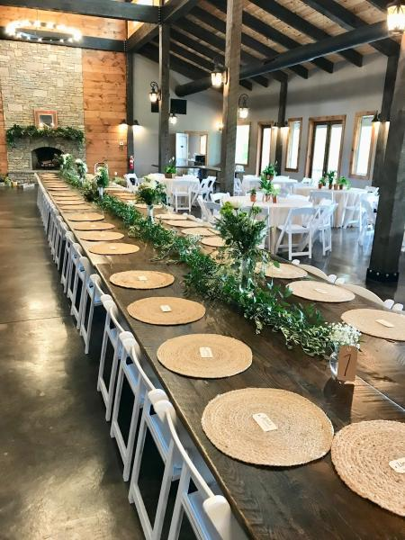 Farm table with garland at Blue Mountain Vineyard]