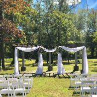 Flowing with white fabric and accented with flowers, this is a beautiful site to see.