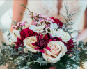 Popular bouquet of wild flower with touches of blush, merlot and blue.  Venue Juliette Chapel in Dahlonega