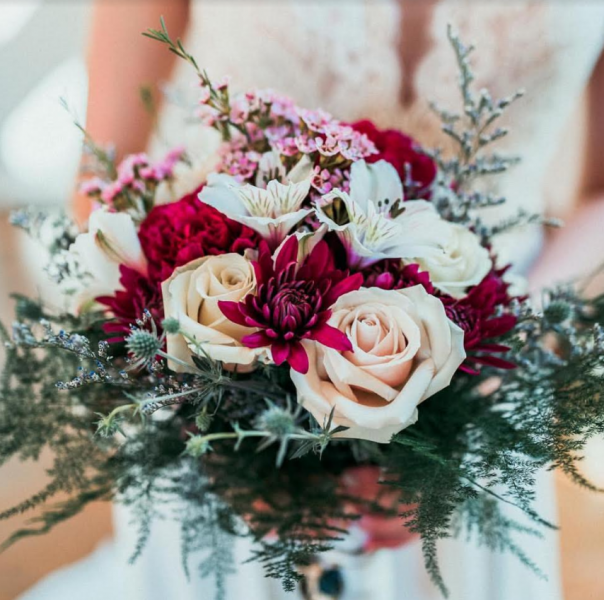 [Image: Popular bouquet of wild flower with touches of blush, merlot and blue.  Venue Juliette Chapel in Dahlonega ]
