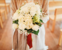 A winter wedding at Juliette Chapel in Dahlonega was beautiful in shades of white hydrangea and roses.
