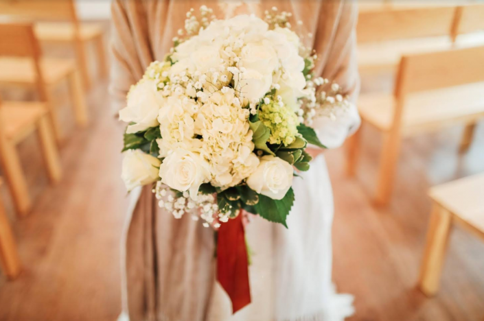 [Image: A winter wedding at Juliette Chapel in Dahlonega was beautiful in shades of white hydrangea and roses. ]